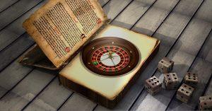 Buch mit einem Roulette-Kessel im Buchband